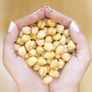 Chickpeas in woman hands